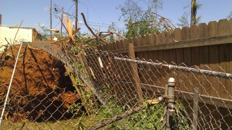 Tore up fence. (photo by Tanya Mikulas)